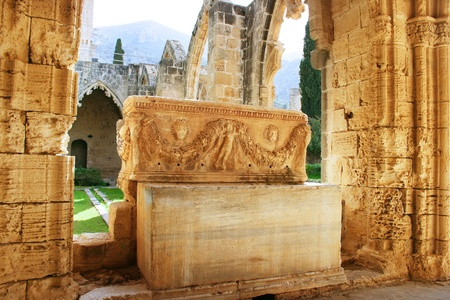 between: Historic Bellapais Abbey in Kyrenia, Northern Cyprus.Original construction was built between 1198-1205, it is the most beautiful Gothic building in the Near East.