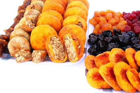 Dried fruits in trays  isolated on white background. photo