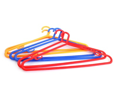 Colorful hangers isolated on white background. photo