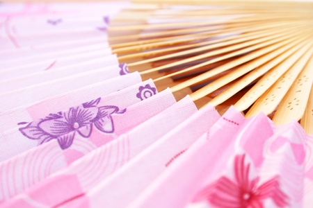 Pink opened fan as a background. photo