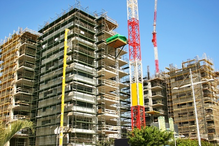 residential construction: Construction site and crane in Limassol city, Cyprus. Stock Photo