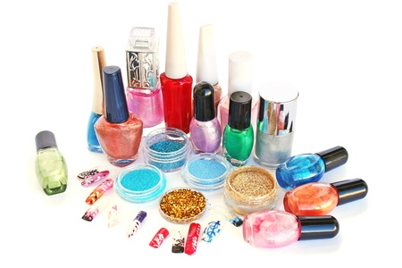 Nail polishes,glitters and nail figures isolated on white background.