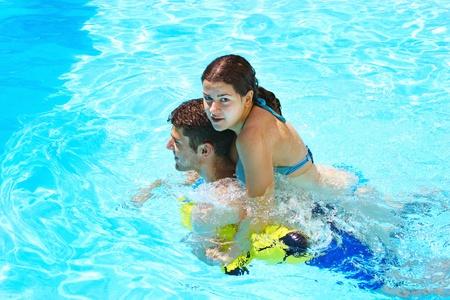 Couple having fun in swimming pool. photo