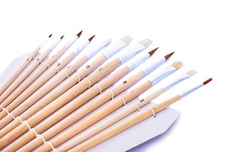 Set of painting brushes isolated on white background. photo