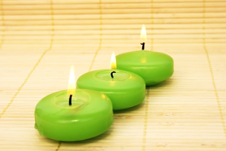 Green candles on bamboo background. Stock Photo - 10045894