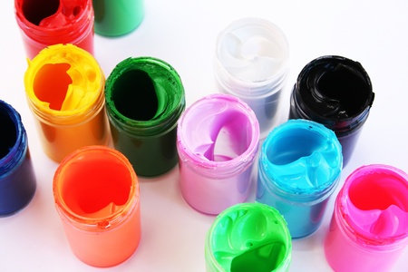 Colorful paints bottles on gray background. Stock Photo - 10045921