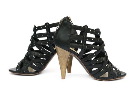 bottons: Womanish shoes isolated on white background.