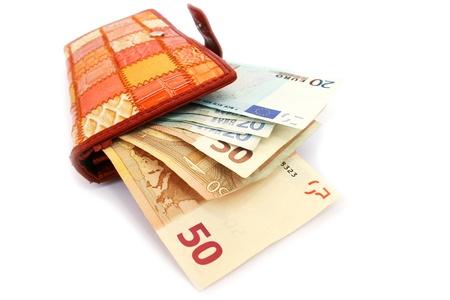 Geld in portefeuille op een witte achtergrond. Stockfoto