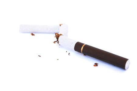 Broken cigarette isolated on white background. photo