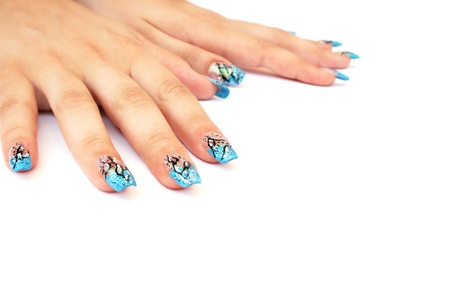 Hands with nail art isolated on white background.