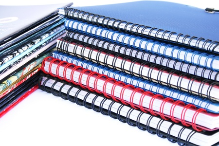 Copybook stacks isolated on white background. photo