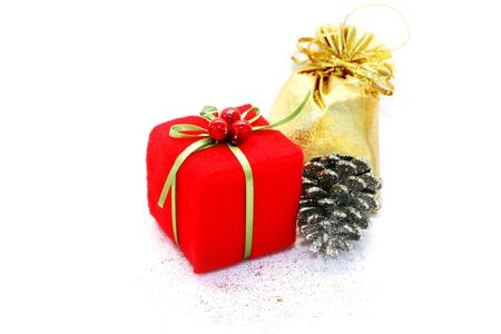 hollyberry: Christmas present boxes and pinecone on white background. Stock Photo