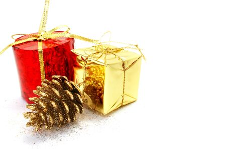 showy: Christmas present boxes and pinecone on white background. Stock Photo