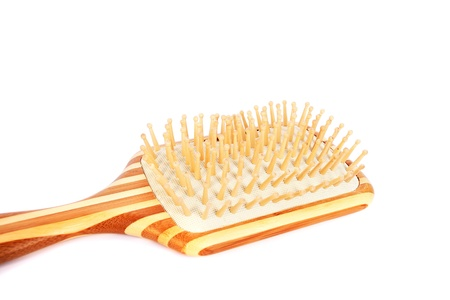 Wooden comb isolated on white background. photo