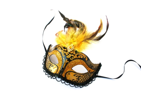 Yellow mask with feathers isolated on white background.