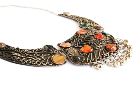Armenian ancient style necklace with natural stones isolated on white background. Standard-Bild