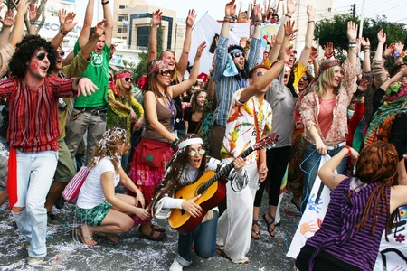 LIMASSOL, CYPRUS - MARCH 6: Unidentified participants  in hippie costumes in Cyprus carnival parade on March 6, 2011 in Limassol, Cyprus. Cyprus carnival has been celebrating since 16th century, influenced by Venetian and Greek traditions.The festival is  Редакционное