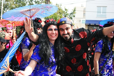 LIMASSOL, CYPRUS - MARCH 6: Unidentified participants  in Chinese costumes in Cyprus carnival parade on March 6, 2011 in Limassol, Cyprus. Cyprus carnival has been celebrating since 16th century, influenced by Venetian and Greek traditions.The festival is