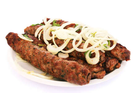 Fresh grilled beef  kebab with onion isolated on white background. photo
