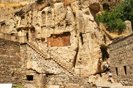 Geghard monastery in Armenia, unique architectural construction, being partially carved out of the adjacent mountain, surrounded by cliffs. the monastery complex was founded in the 4th century.
