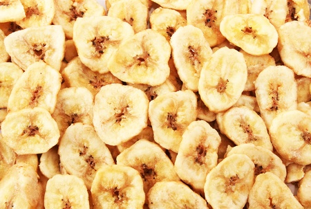 Banana chips as a background. photo