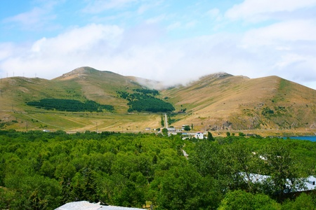 Armenian landscape with mountains, forest and village  photo
