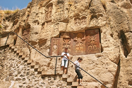 apostolic: Geghard monastery in Armenia, unique architectural construction, being partially carved out of the adjacent mountain, surrounded by cliffs. UNESCO World Heritage Site,the monastery complex was founded in the 4th century.