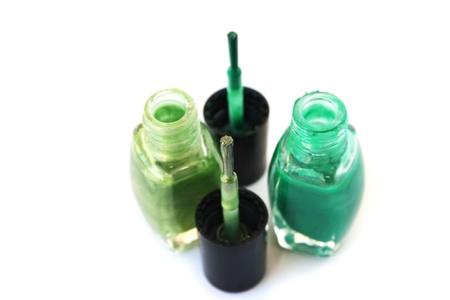 Green nail polishes isolated on white background. Stock Photo - 13559568