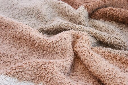 terry: Brown and beige towel texture as a background. Stock Photo