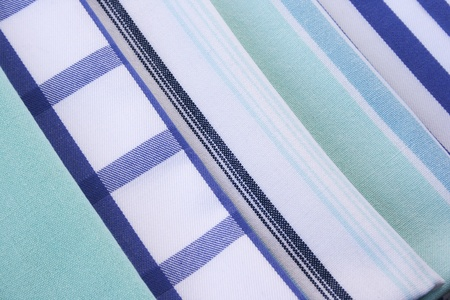 Colorful kitchen towels as a background. photo