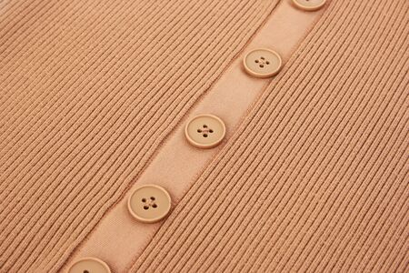 Beige knitwear as a background. photo
