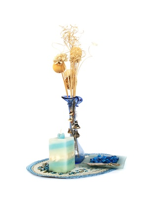 Blue vase with flowers, candle, ash-tray, table overlay isolated on white background. photo