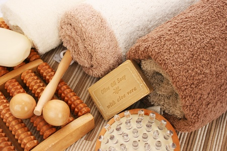 Towels and spa set on mat background  photo