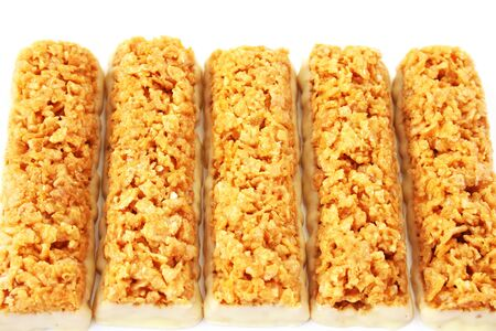 Cereal bars with white chocolate isolated on white background. photo