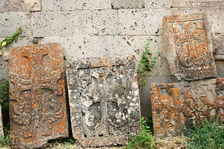 apostolic: Cross-stones or khachkars at the 9th century Armenian monastery of Tatev. Khachkars are carved memorial stele, covered with rosettes and other patterns, unique art  of Medieval Christian Armenia.There are several thousand cross-stones in Armenia, each dis