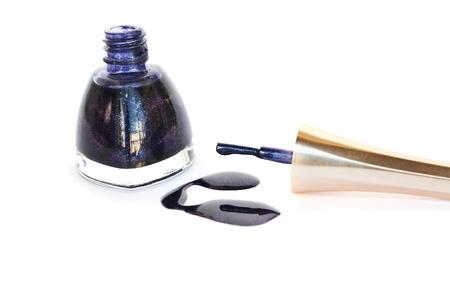 Spilled nail polish isolated on white background  photo