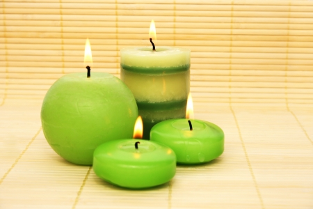 Green candles on bamboo background  photo
