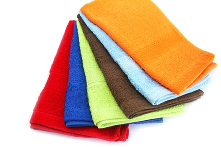 Colorful towels on white background. photo