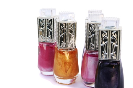 Colorful nail polishes isolated on white background  photo