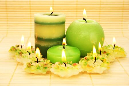 Green candles on bamboo background. photo
