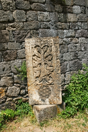 Cross-stones or khachkars at the 9th century Armenian monastery of Tatev. Khachkars are carved memorial stele, covered with rosettes and other patterns, unique art  of Medieval Christian Armenia.There are several thousand cross-stones in Armenia, each dis photo