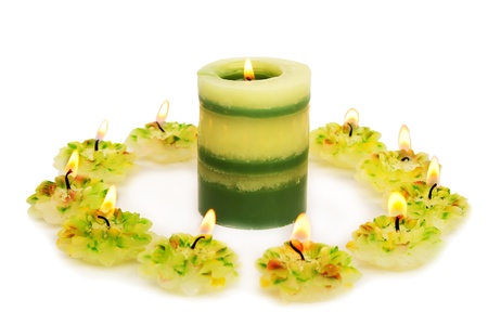 Green candles  isolated on white background. photo