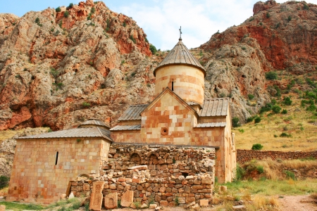 Noravank monastery in Armenia, red rocky mountains. photo