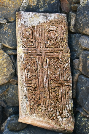 Cross-stones or khachkars at the 9th century Armenian monastery of Sevanavank. Khachkars are carved memorial stele, covered with rosettes and other patterns, unique art  of Medieval Christian Armenia.There are several thousand cross-stones in Armenia, eac photo