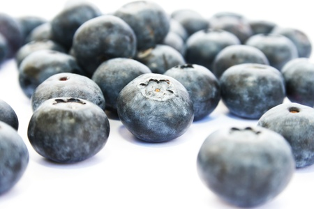 Pile of   blueberries isolated on white background. photo