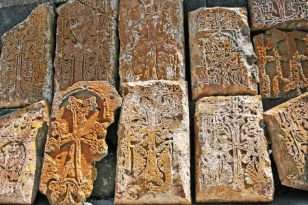 apostolic: Cross-stones or khachkars at the 9th century Armenian monastery of Sevanavank. Khachkars are carved memorial stele, covered with rosettes and other patterns, unique art  of Medieval Christian Armenia.There are several thousand cross-stones in Armenia, eac