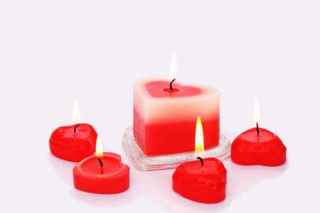 Red candles isolated on grey background. photo