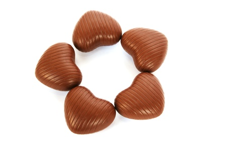 Heart shape chocolates isolated on white background. photo