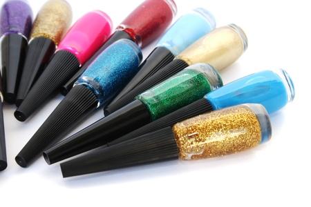 Colorful nail polishes isolated on white background. photo