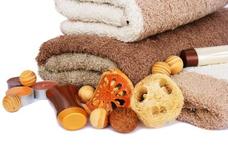 orange washcloth: Towels and spa set isolated on white background.
